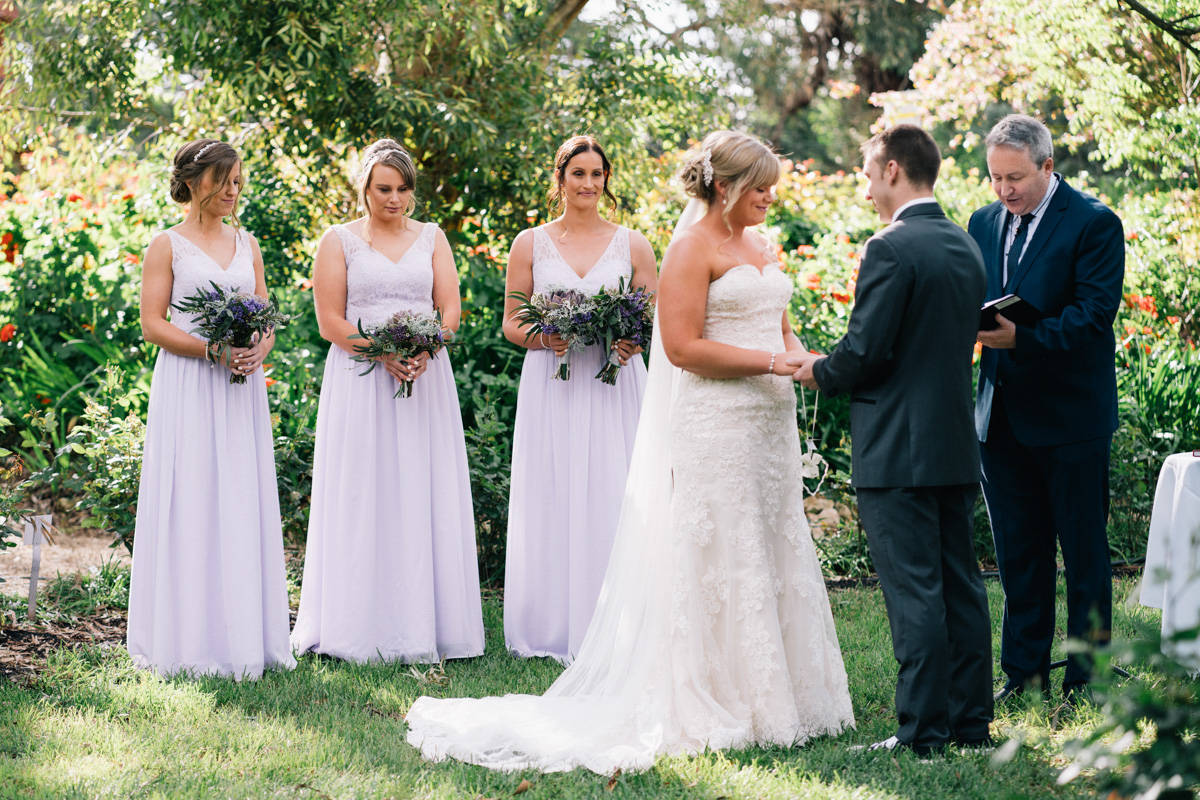 Bride and groom exchanging vows at Barossa chateau wedding