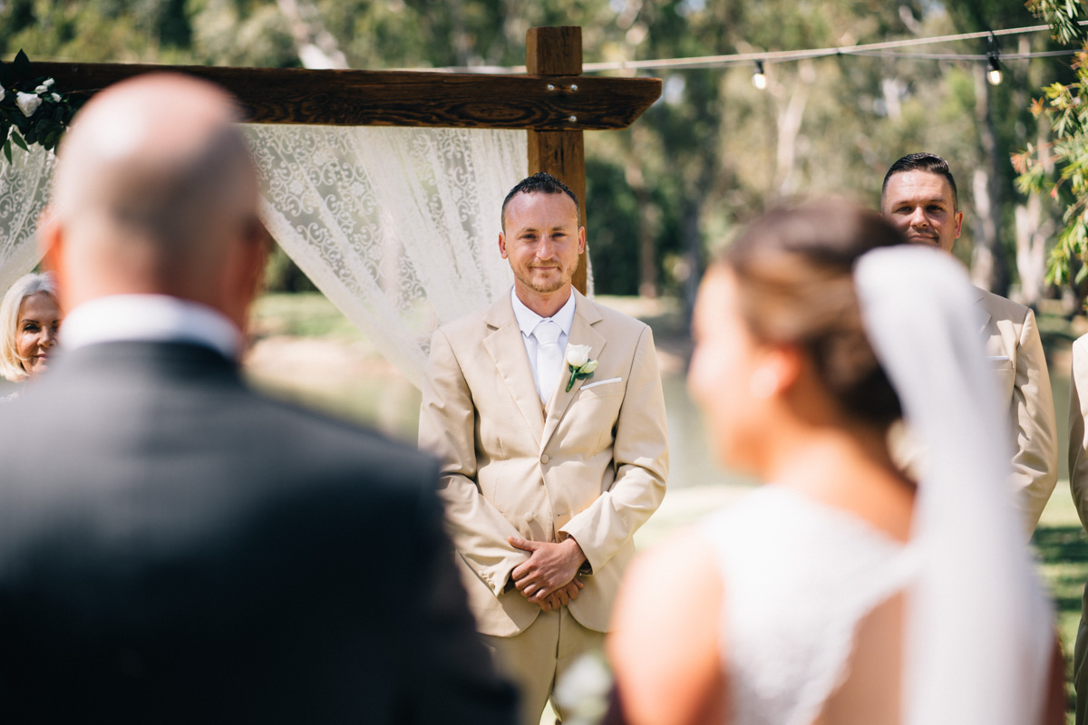 groom seeing bride for the first time at serafino wines