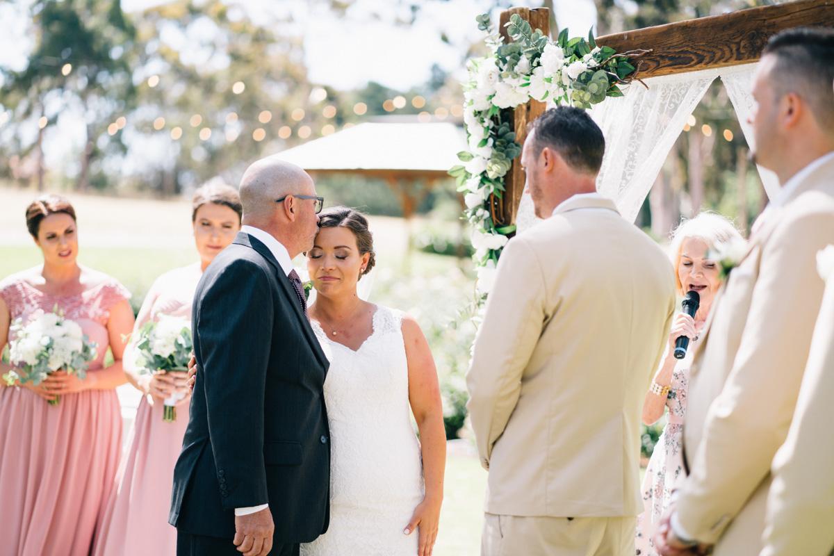 dad giving bride away at serafino wines
