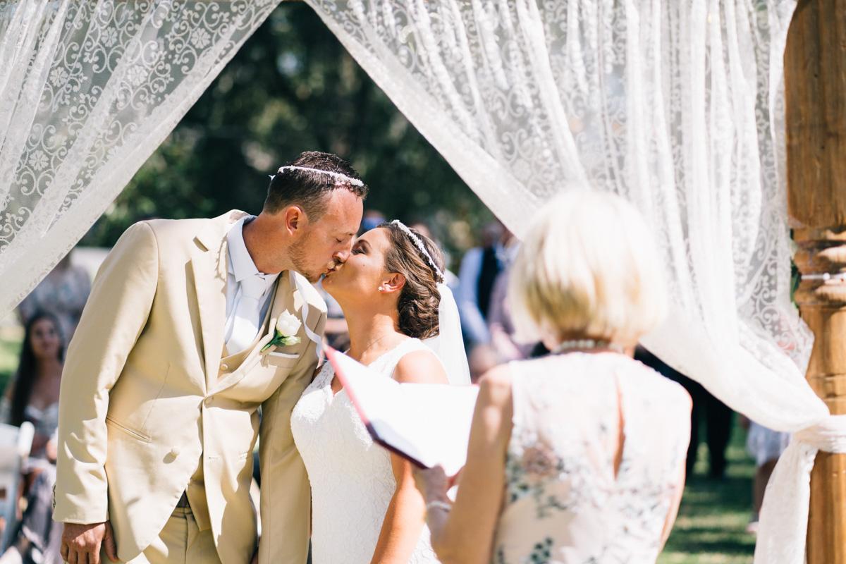 bride kissing groom at serafino wines