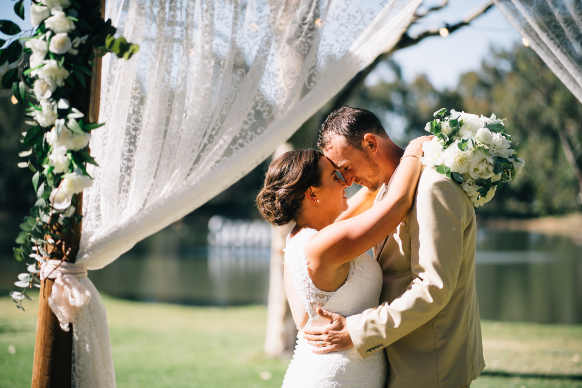 bride and groom together at serafino wines