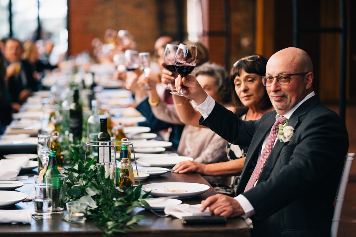 cheers with wine glass at reception