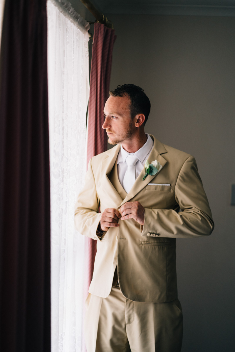 groom by window at home