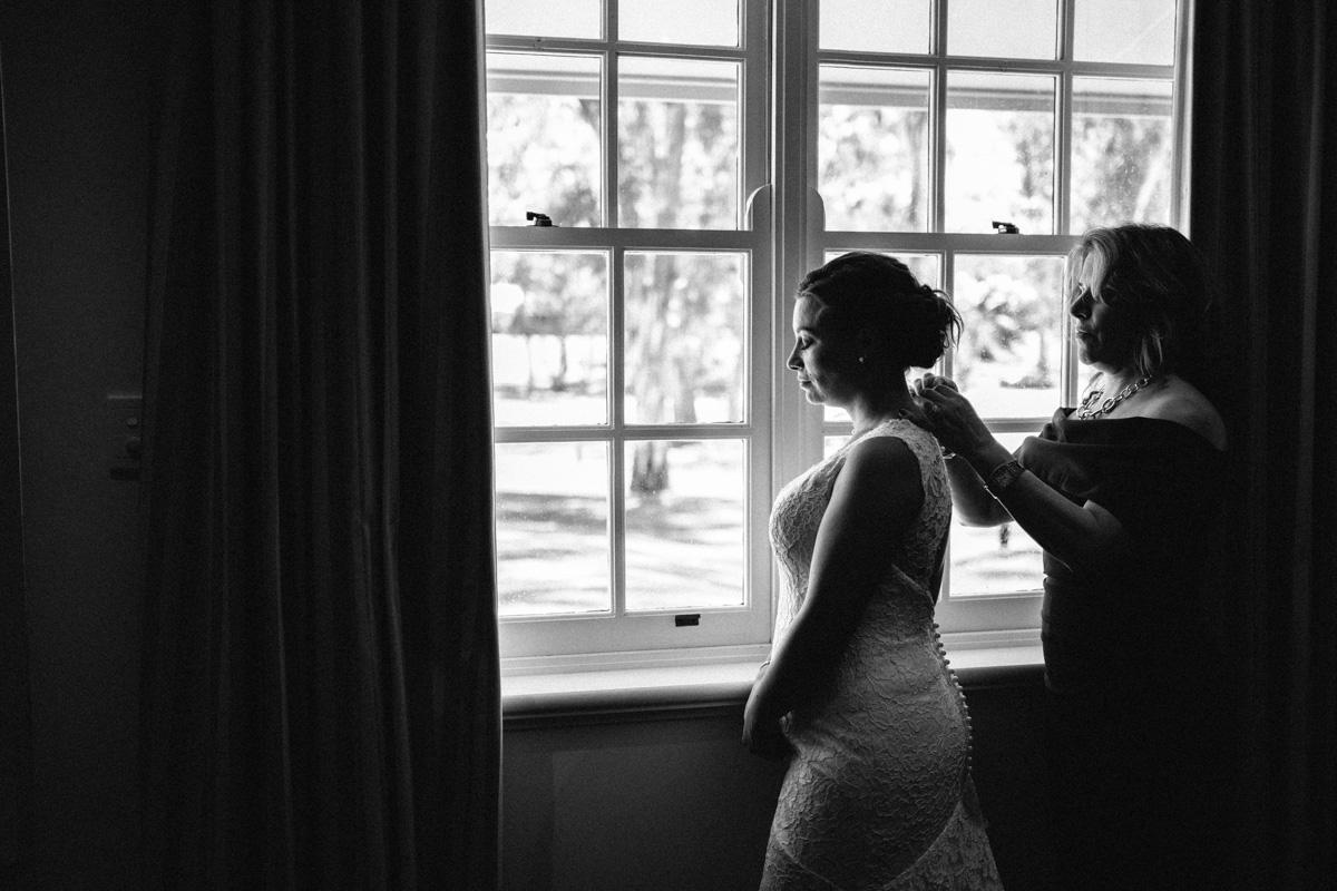 bride getting prepared for wedding at serafino wines