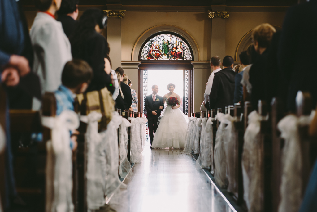 Father with the bride walking down aisle