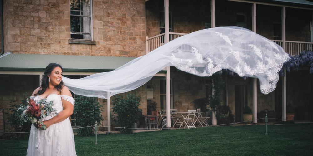 bride looking at veil