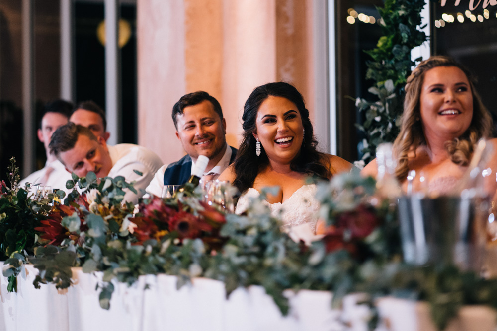 bride laughing at reception
