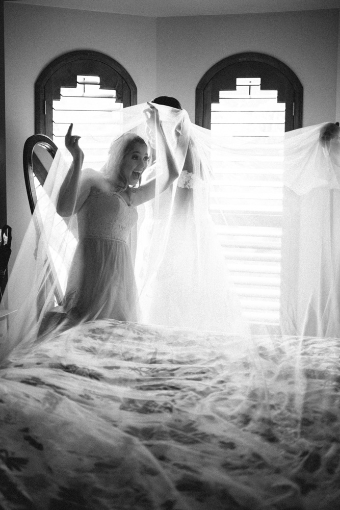 bridesmaid playing with veil