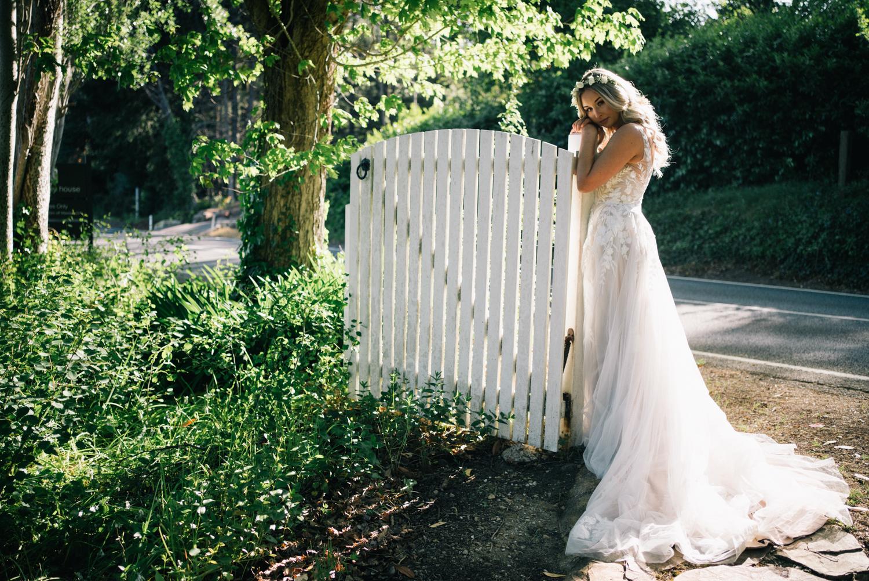 bride next to gate
