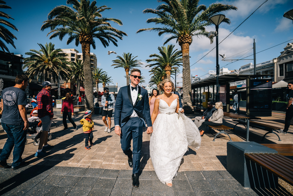 bride and groom walking in Glenelg