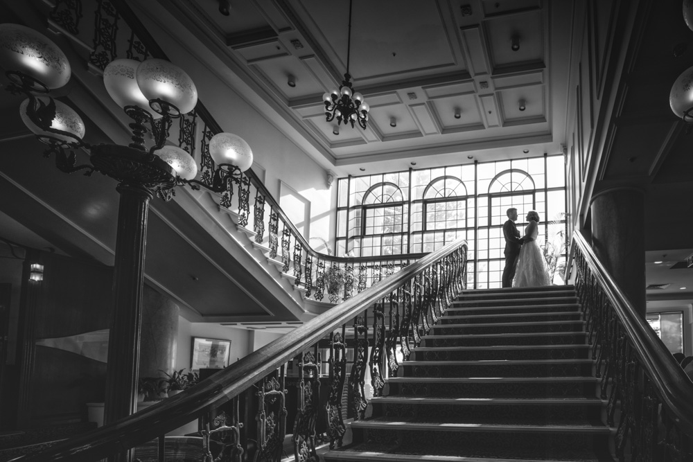 Bride and Groom on Stairs at Stamford Glenelg