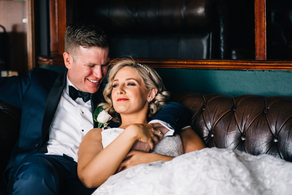 bride lounging with groom