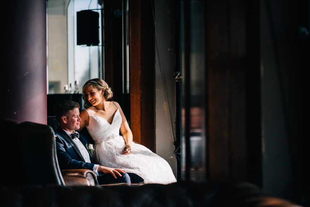 bride sitting with groom