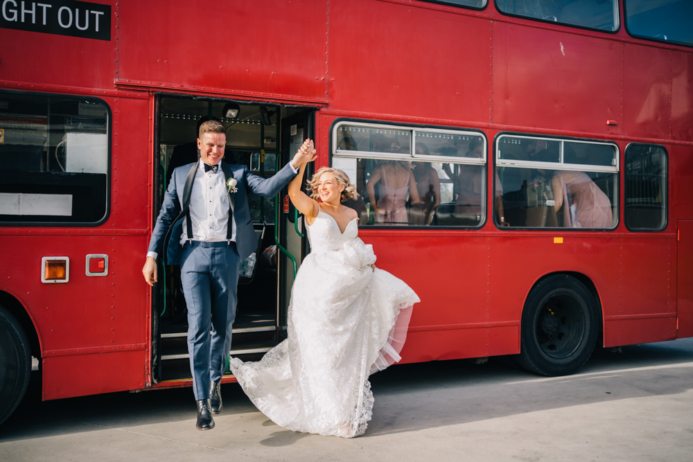 bride and groom stepping off big night out bus