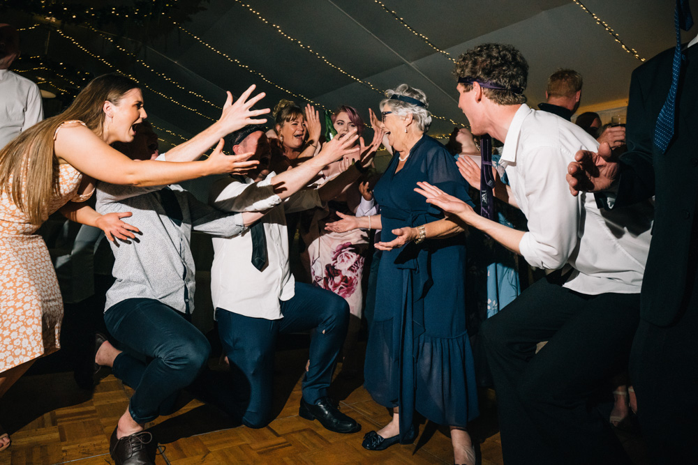 grandmother of the bride singing on reception dancefloor