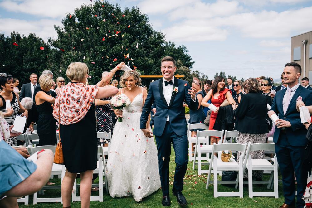 bride with groom showered in flower petals