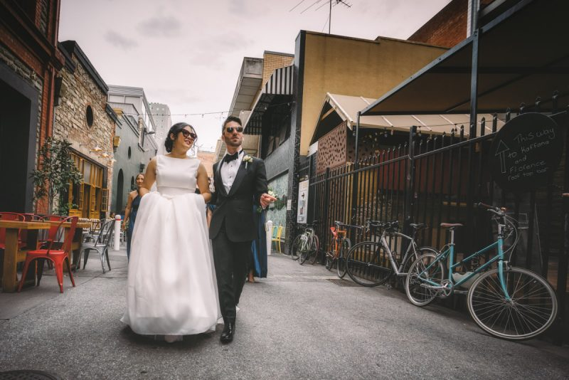 bride and groom walking down street