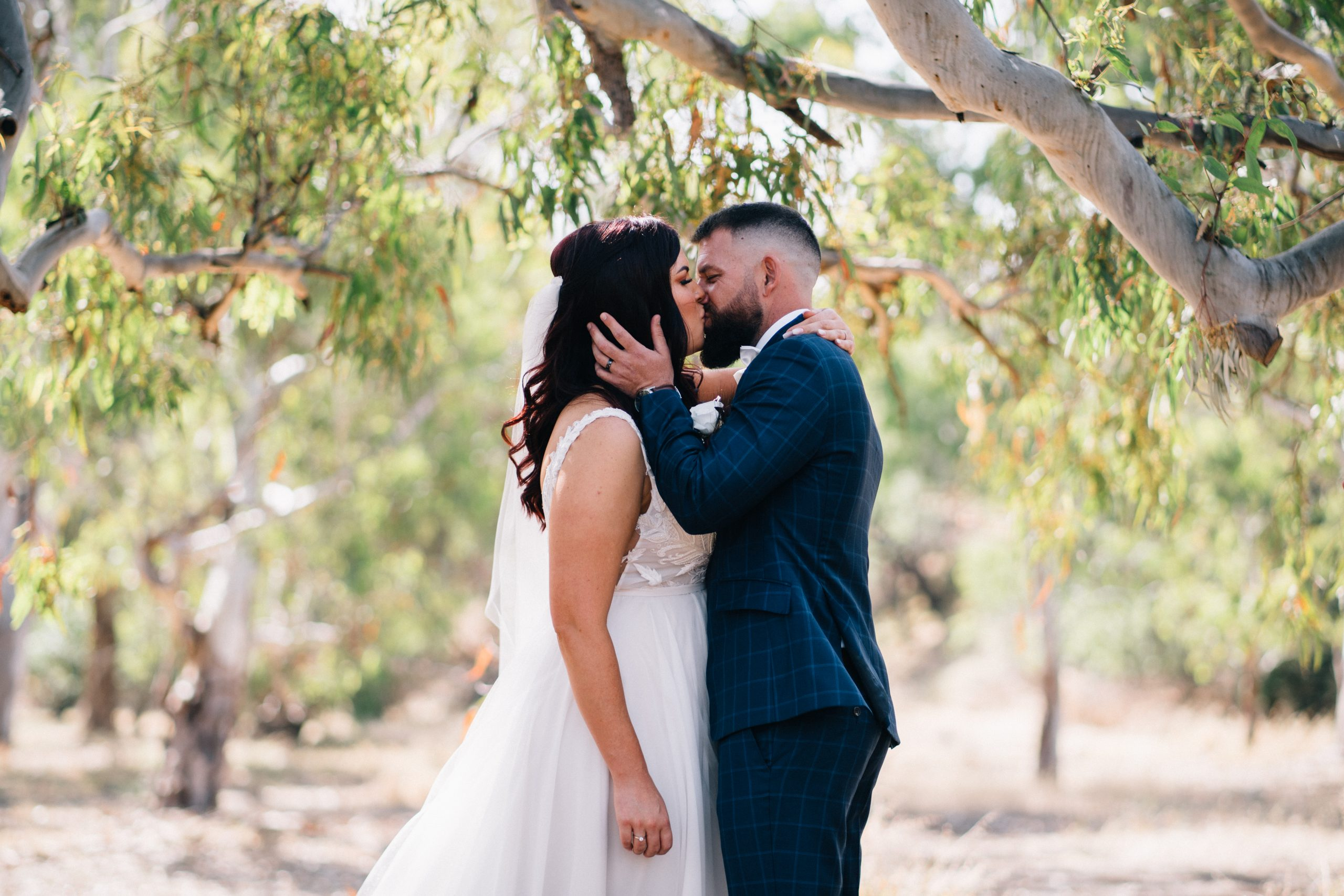 bride and groom kissing during their wedding at brooklyn farm