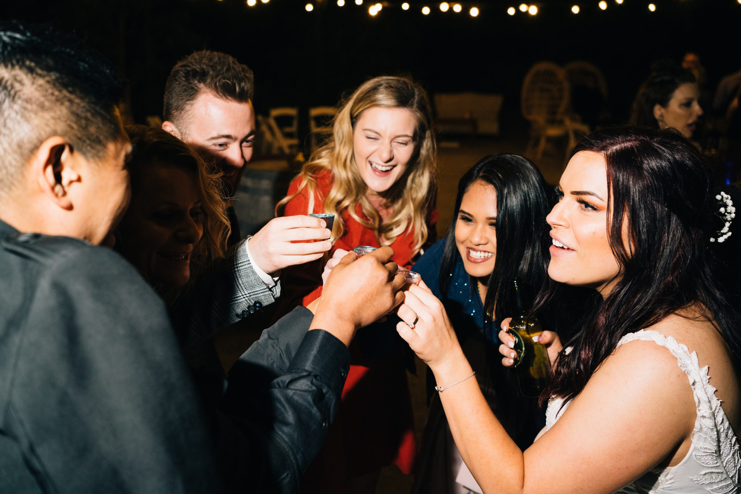 bride at reception drinking shots