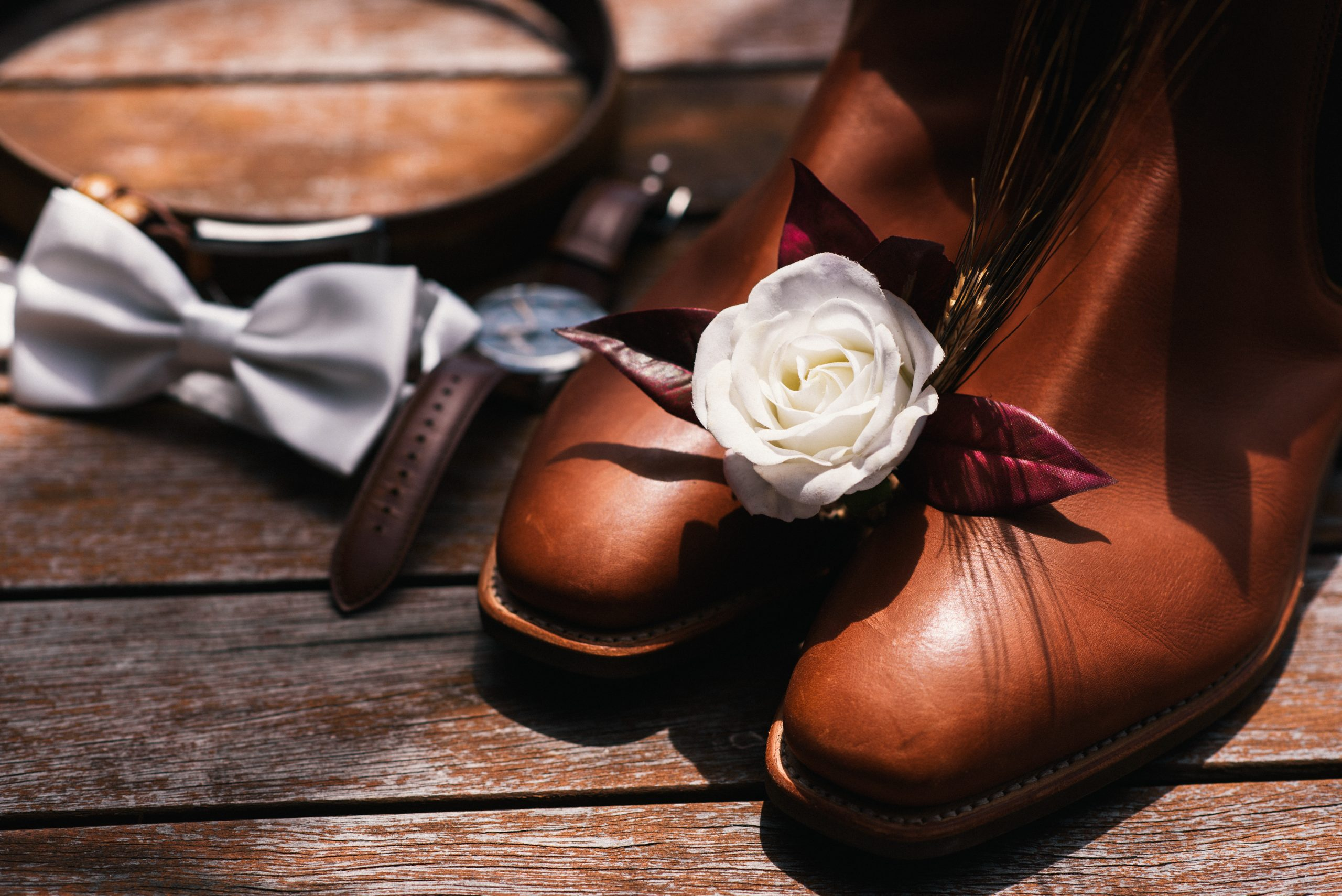 grooms boots, flower and watch
