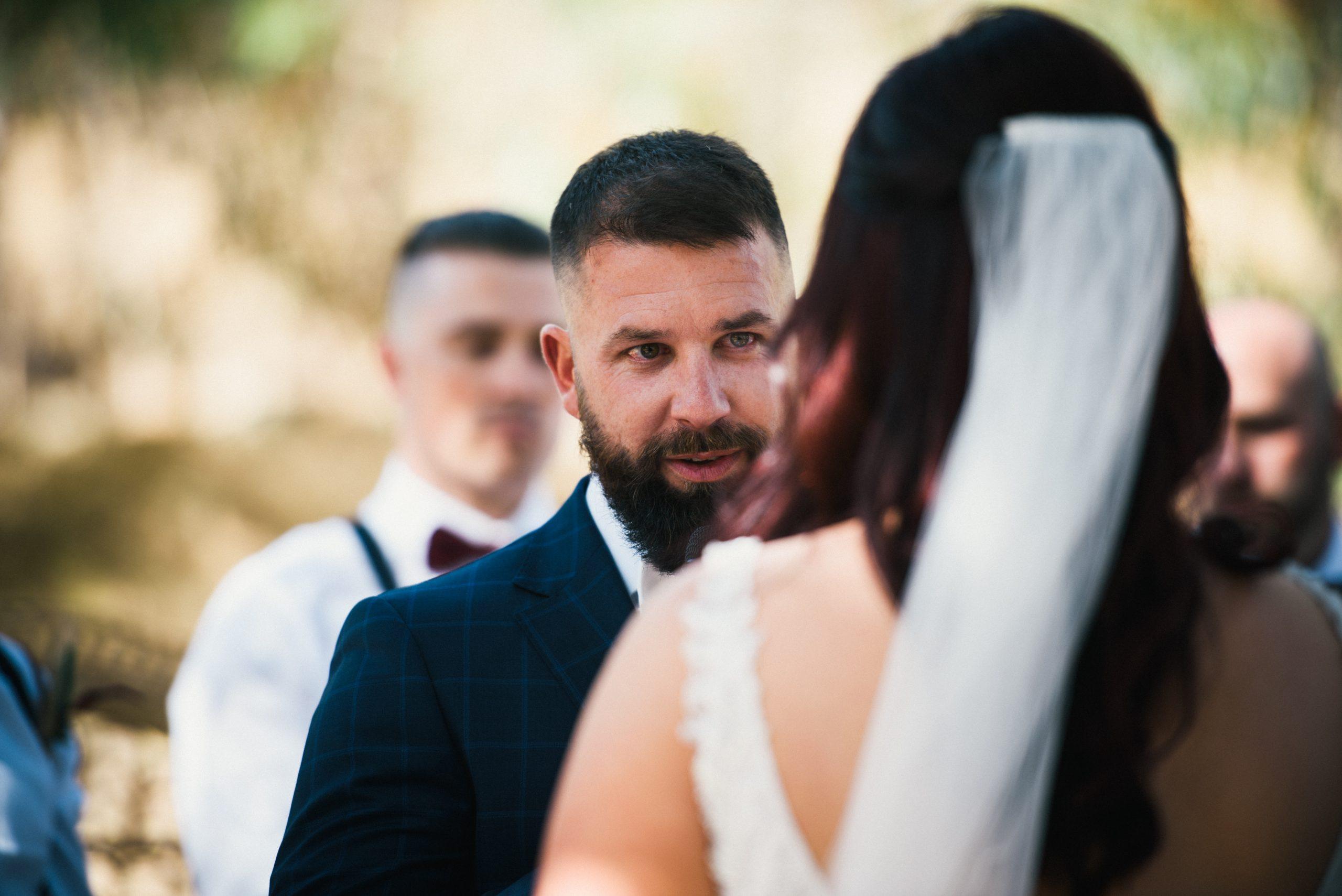 groom looking at bride during the wedding at brooklyn farm