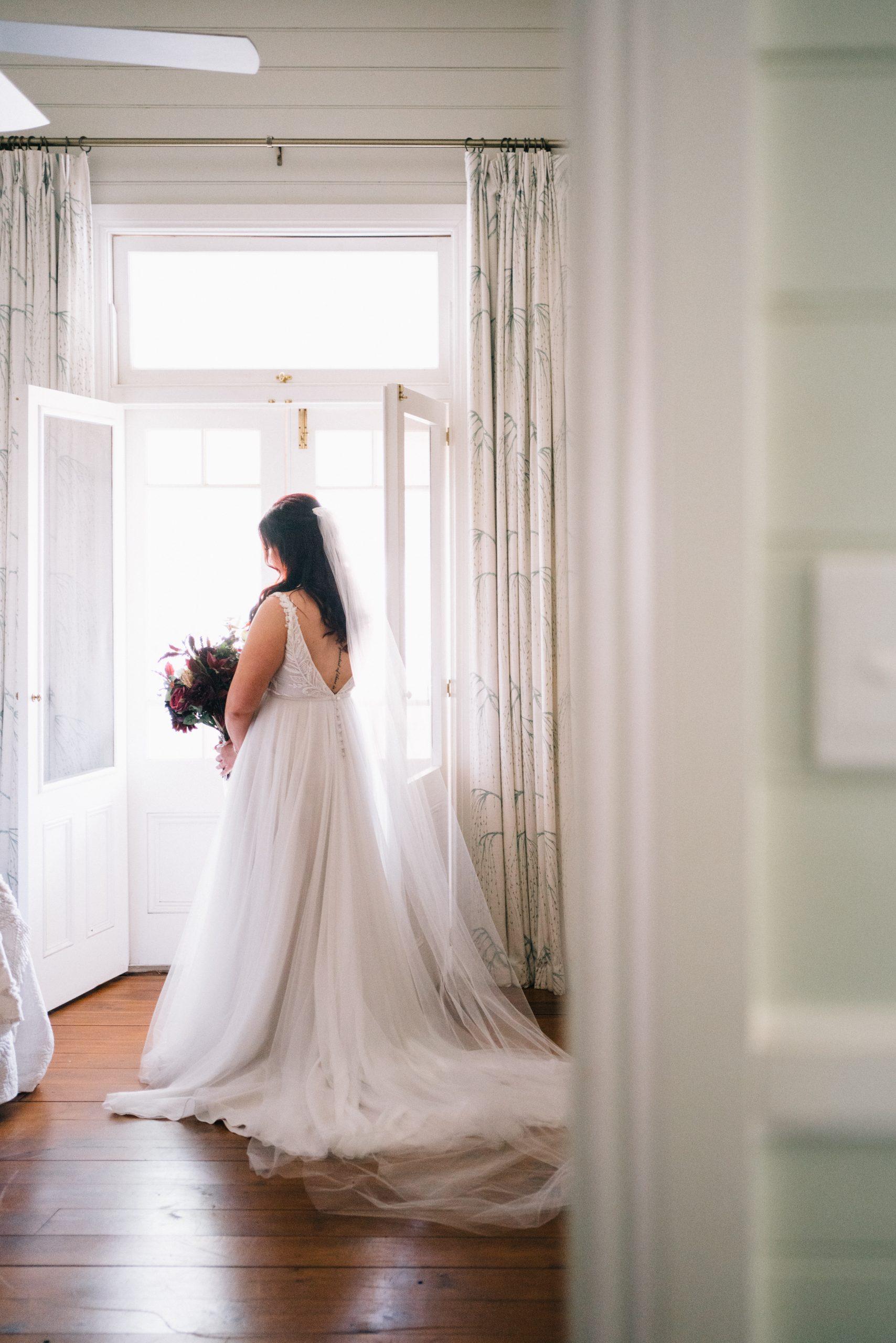 bride posing in bedroom before her wedding at brooklyn farm