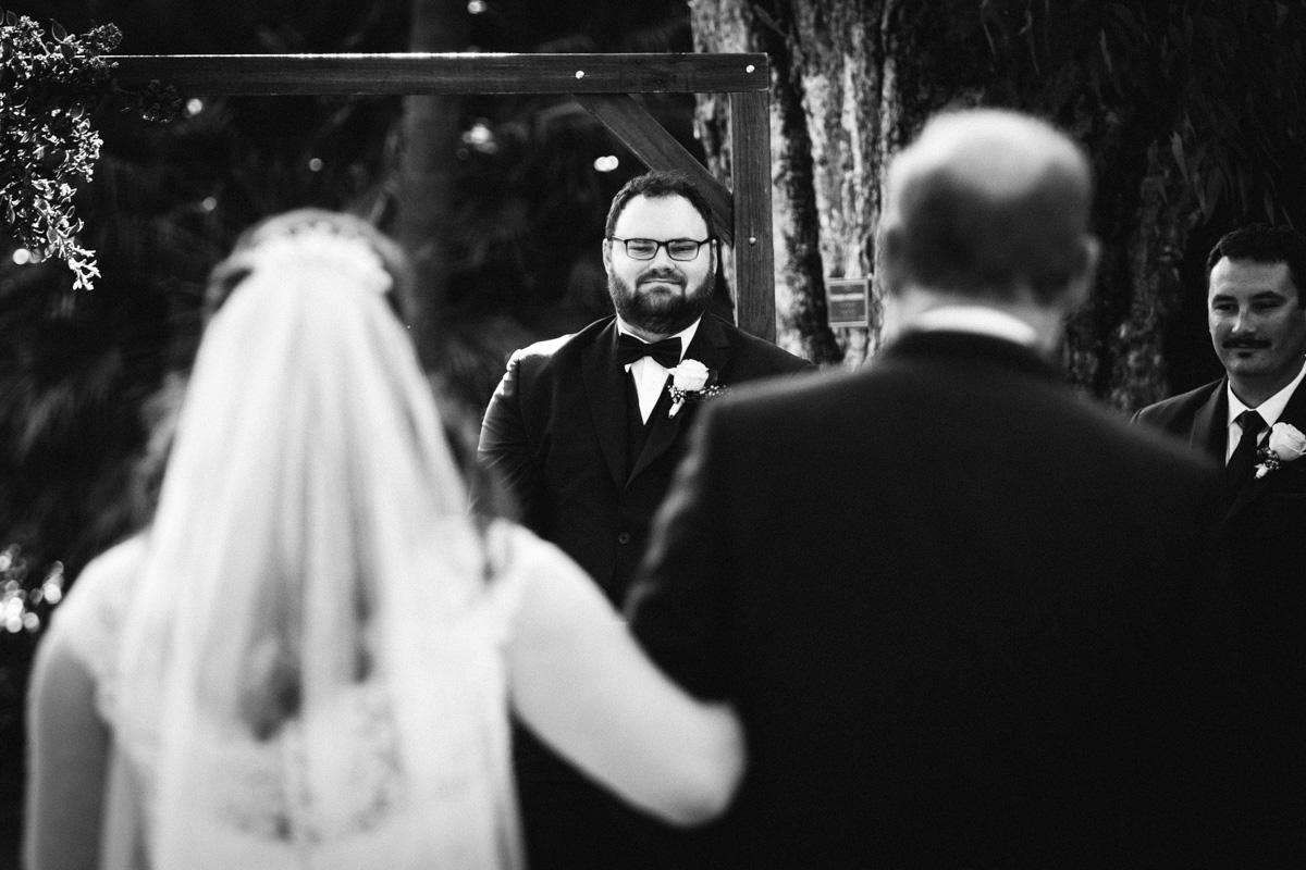 groom seeing bride down the aisle in adelaide botanic gardens
