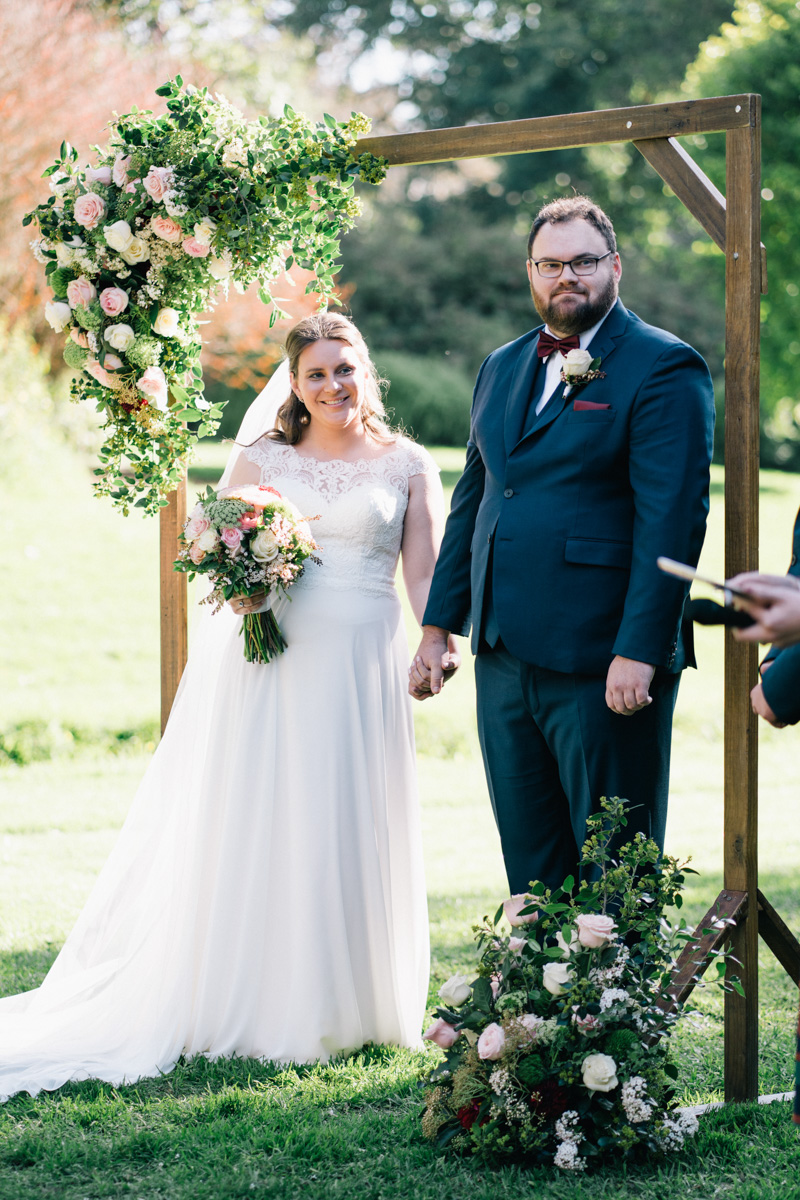 bride and groom together at ceremony in adelaide botanic gardens
