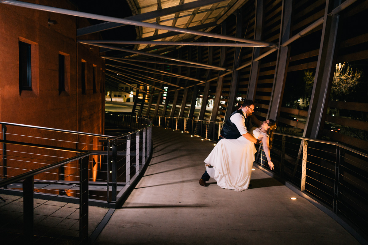 bride and groom dance at entry of wine centre near adelaide botanic gardens