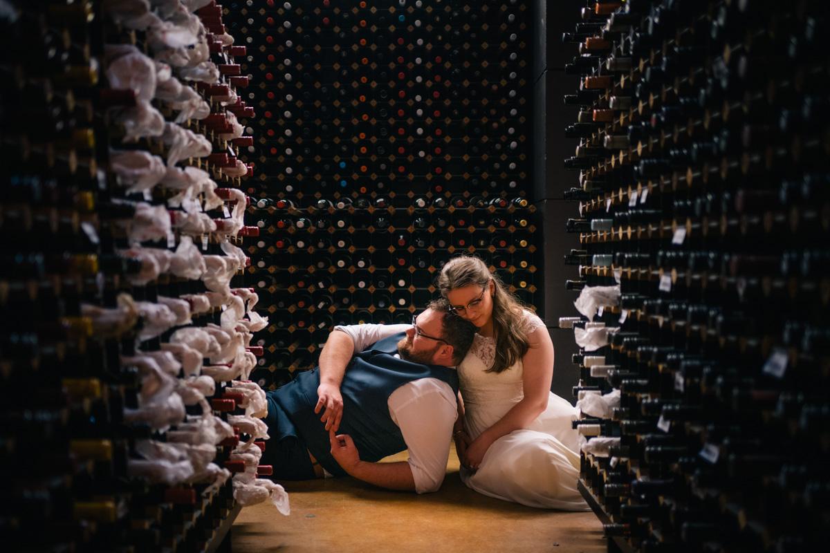 bride and groom in national wine centre cellar near adelaide botanic gardens