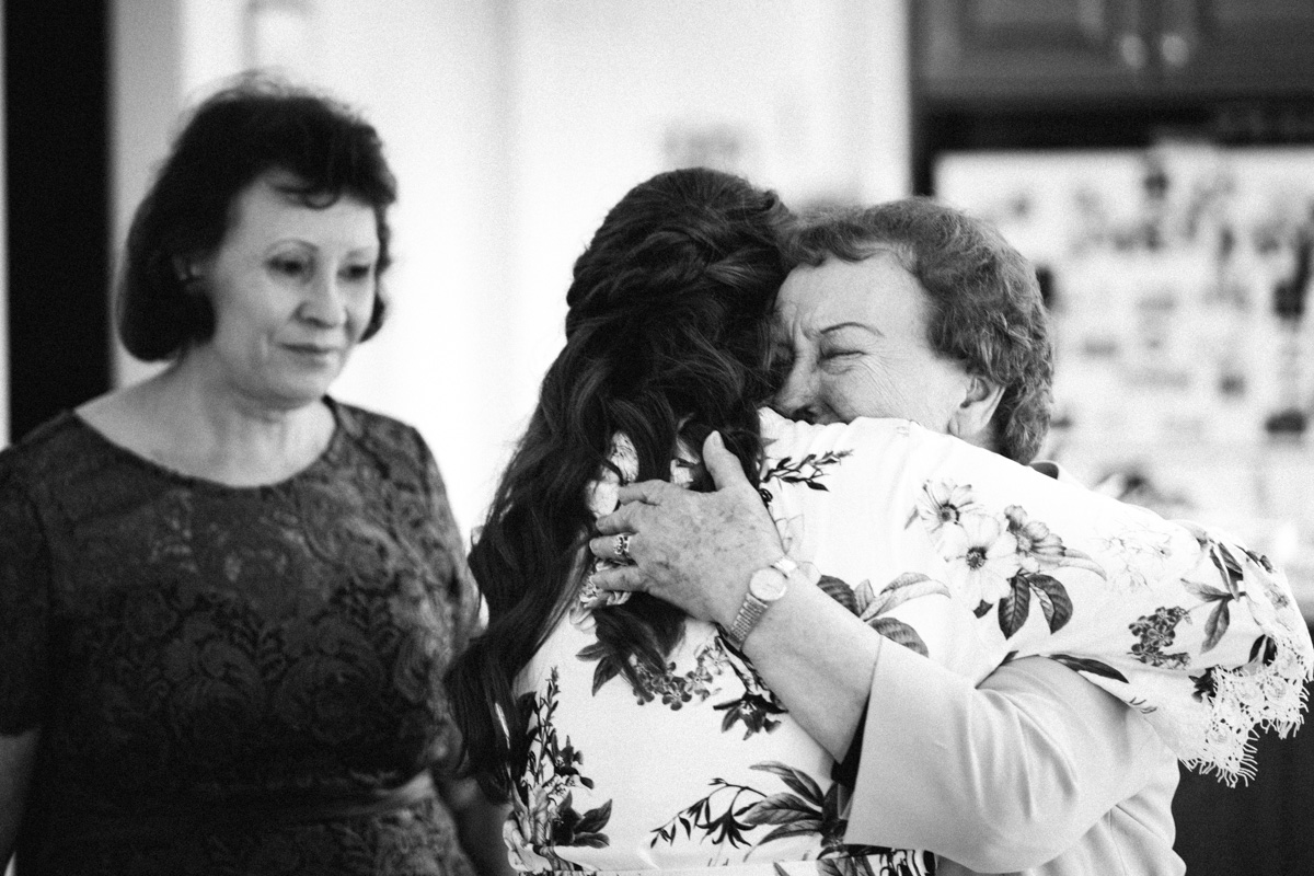 Grandmother hugging bride to be