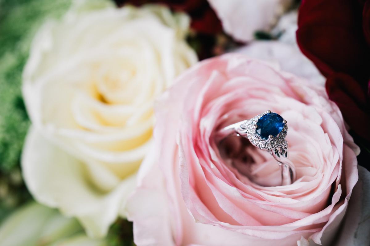 Engagement rings in flowers