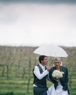 Groom holding umbrella